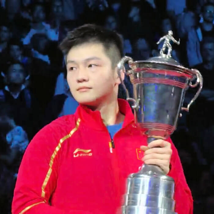 2018 Mens World Cup winner, Fan Zhendong with the World Cup trophy