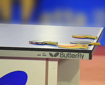 Leave racket on the table during intervals