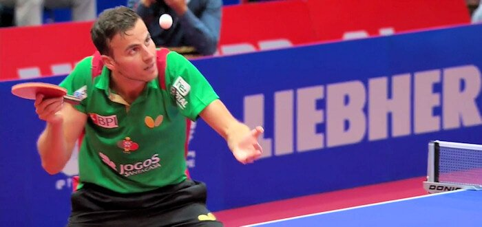 Tiago Apolonia serves the winning point against Emmanuel Lebesson