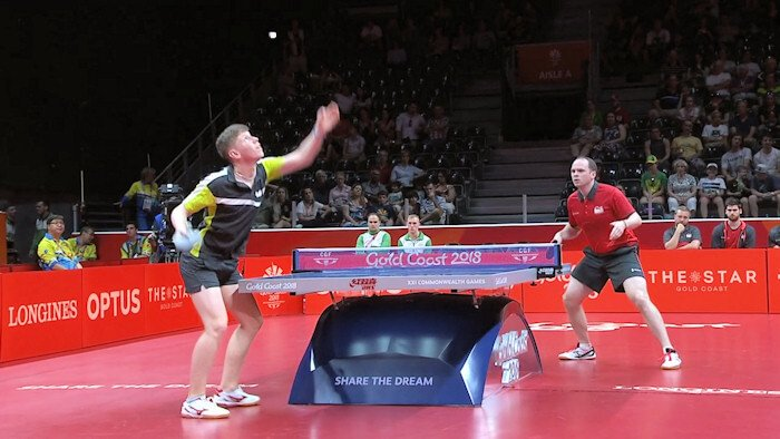 Northern Ireland's Owen Cathcart serving to England's Paul Drinkhall